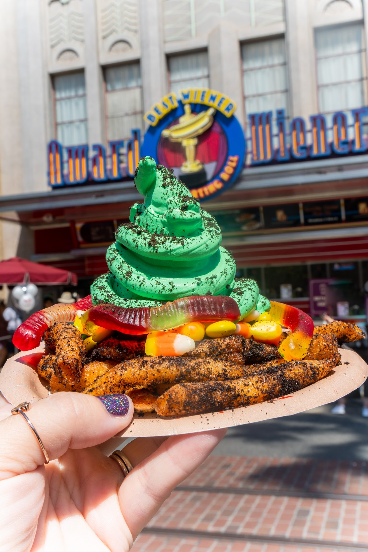 funnel cake fries on a plate with green frosting