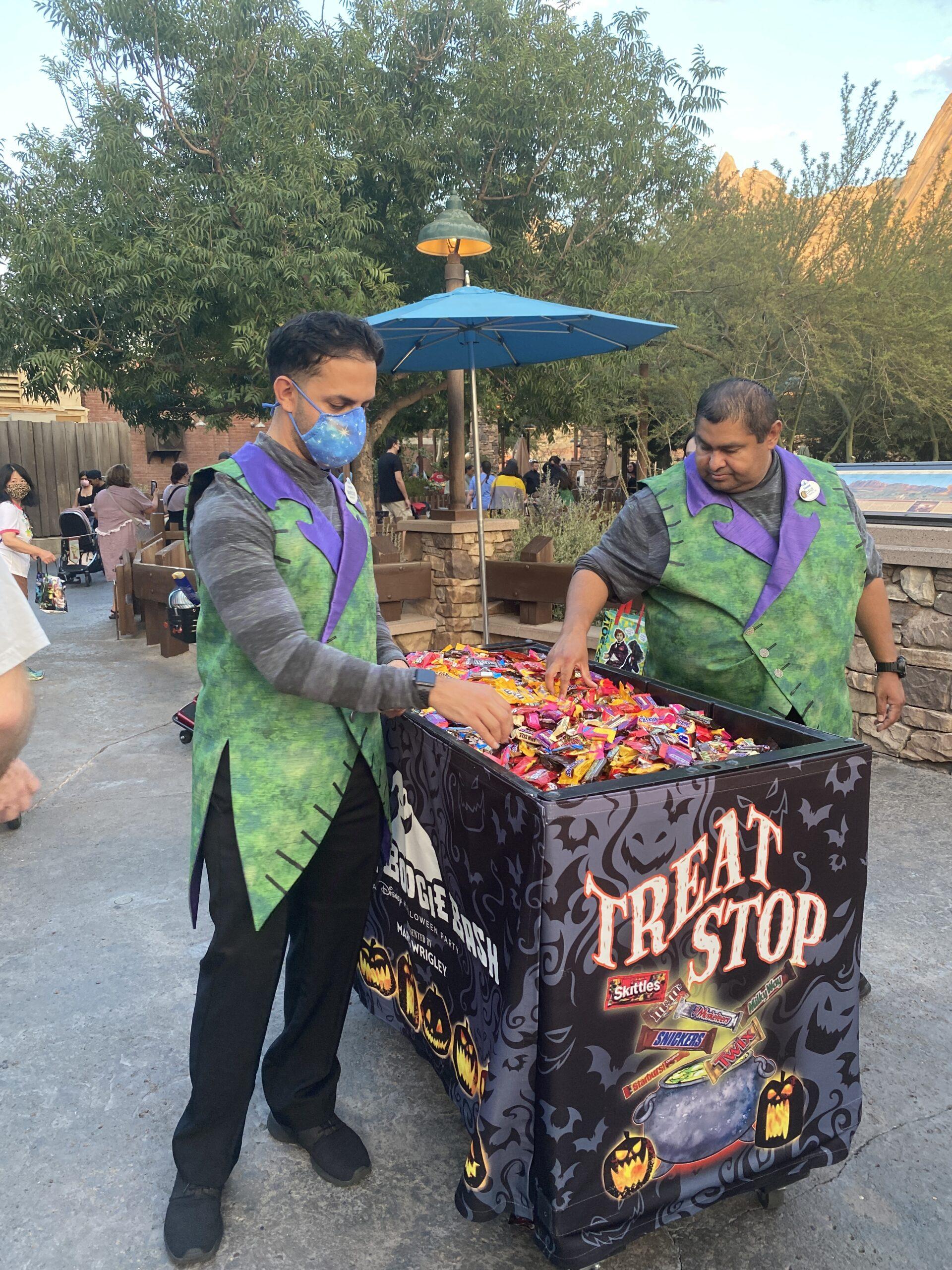 Disney cast member handing out treats