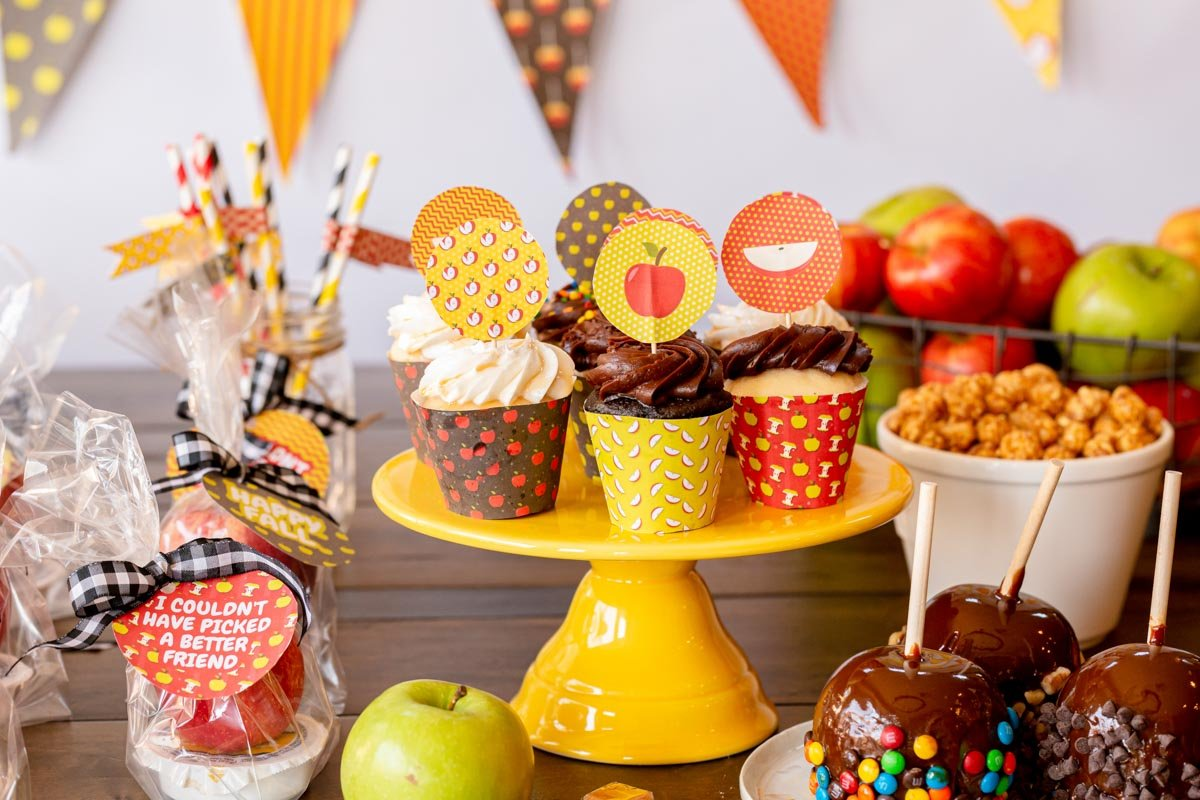 cake stand with cupcakes wrapped in apple cupcake wrappers
