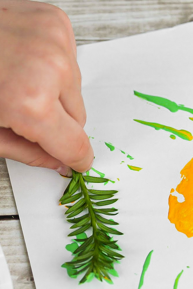 hand painting with a sprig of a bush