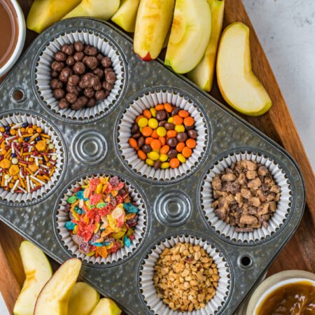 caramel apple toppings in muffin tins