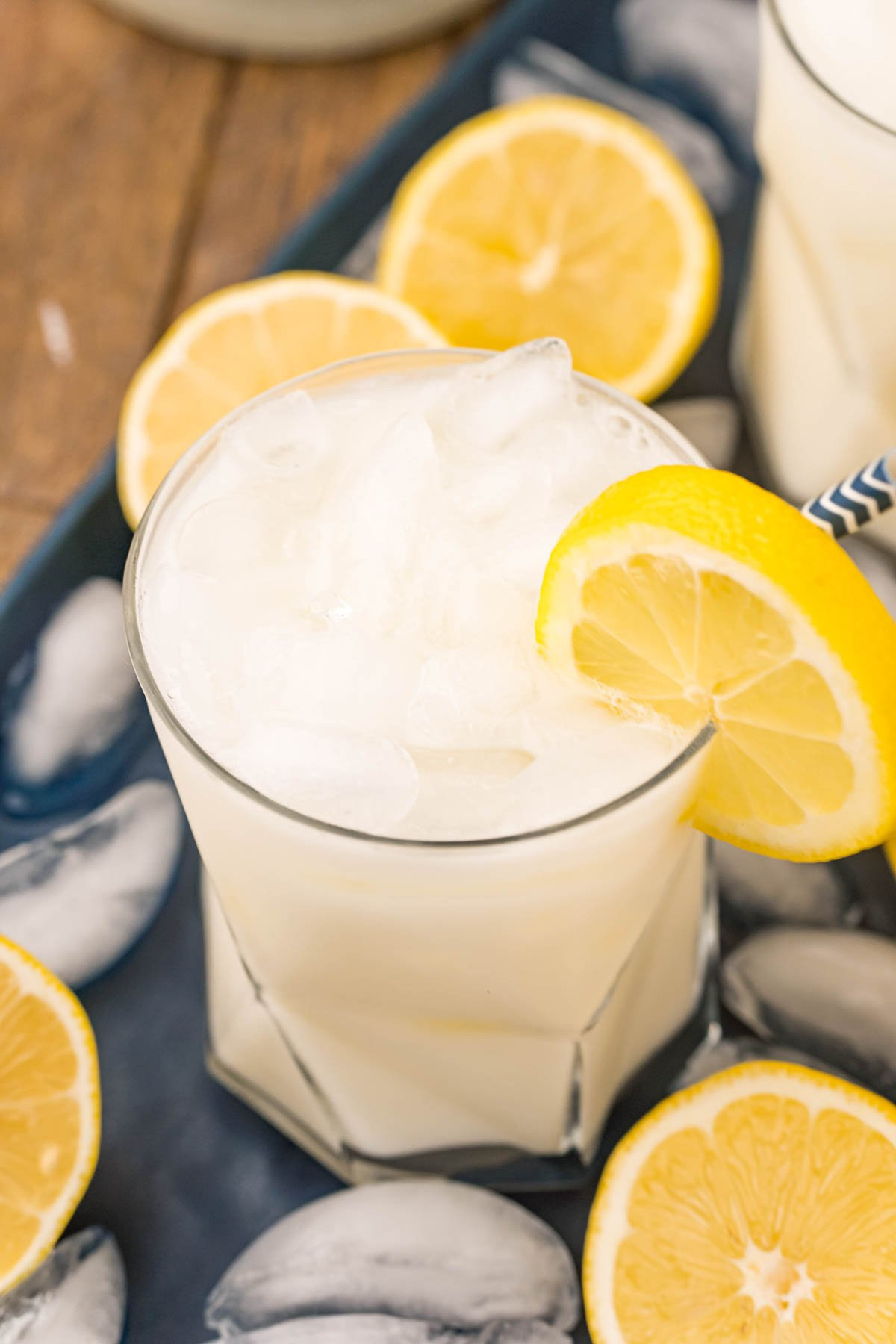glass of creamy lemonade with a lemon slice