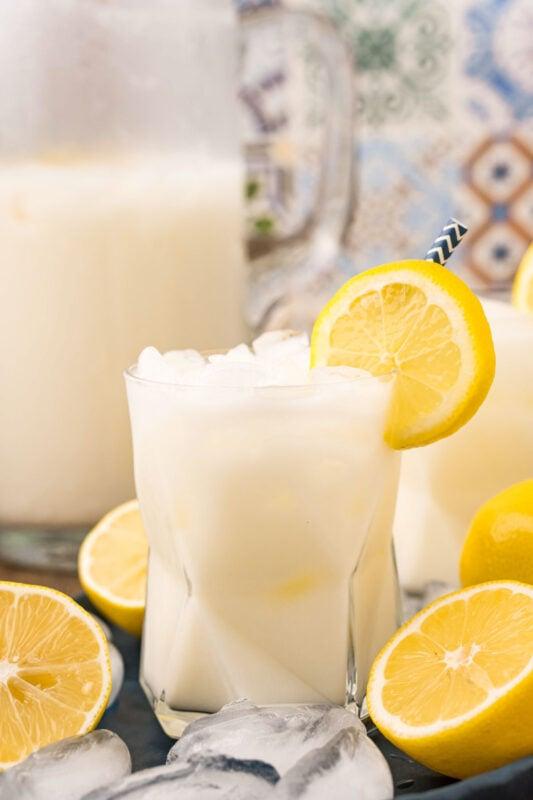 glass of creamy lemonade garnished with lemon slices