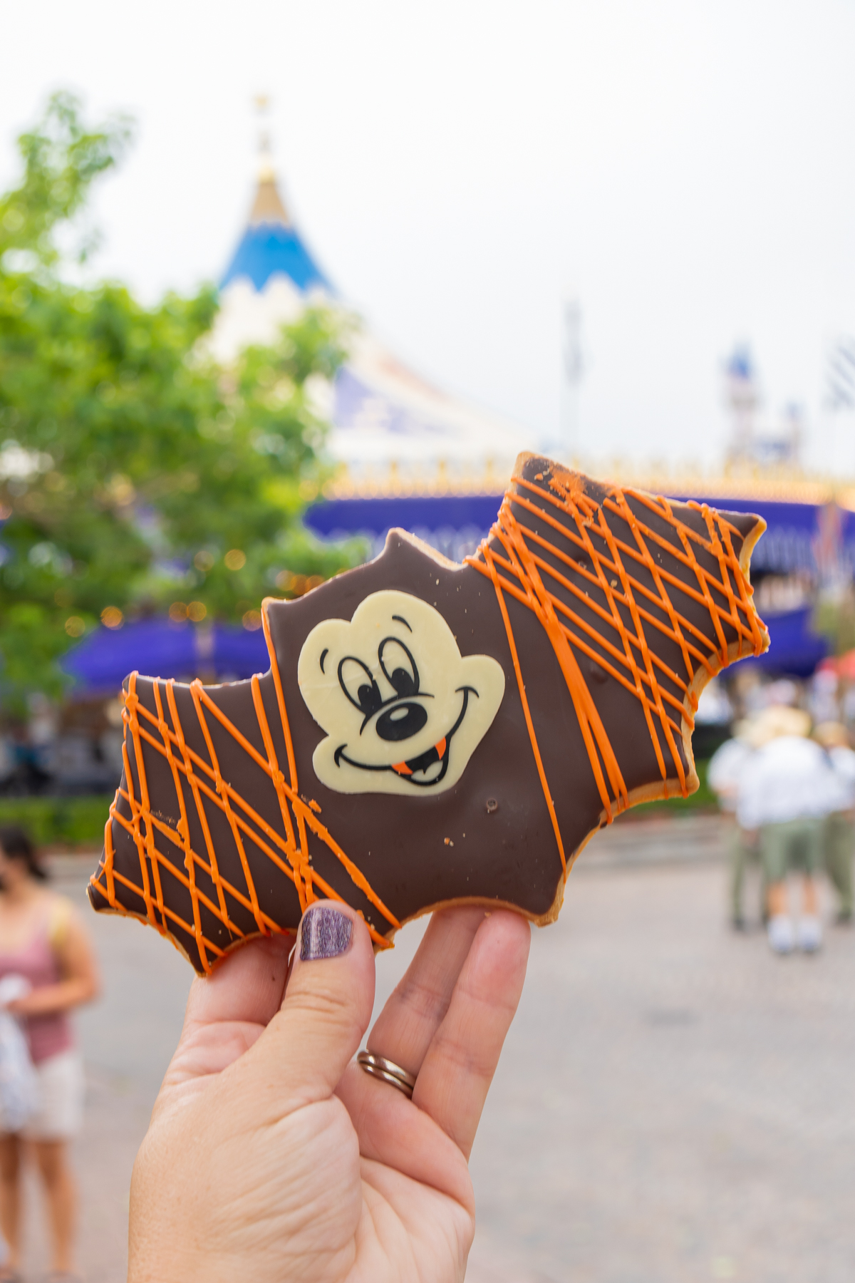 Mickey bat cookie being held by a hand