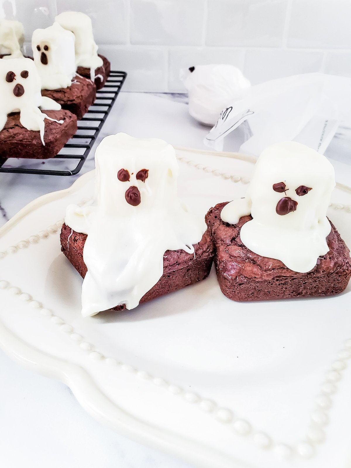 ghost brownies on a white tablecloth