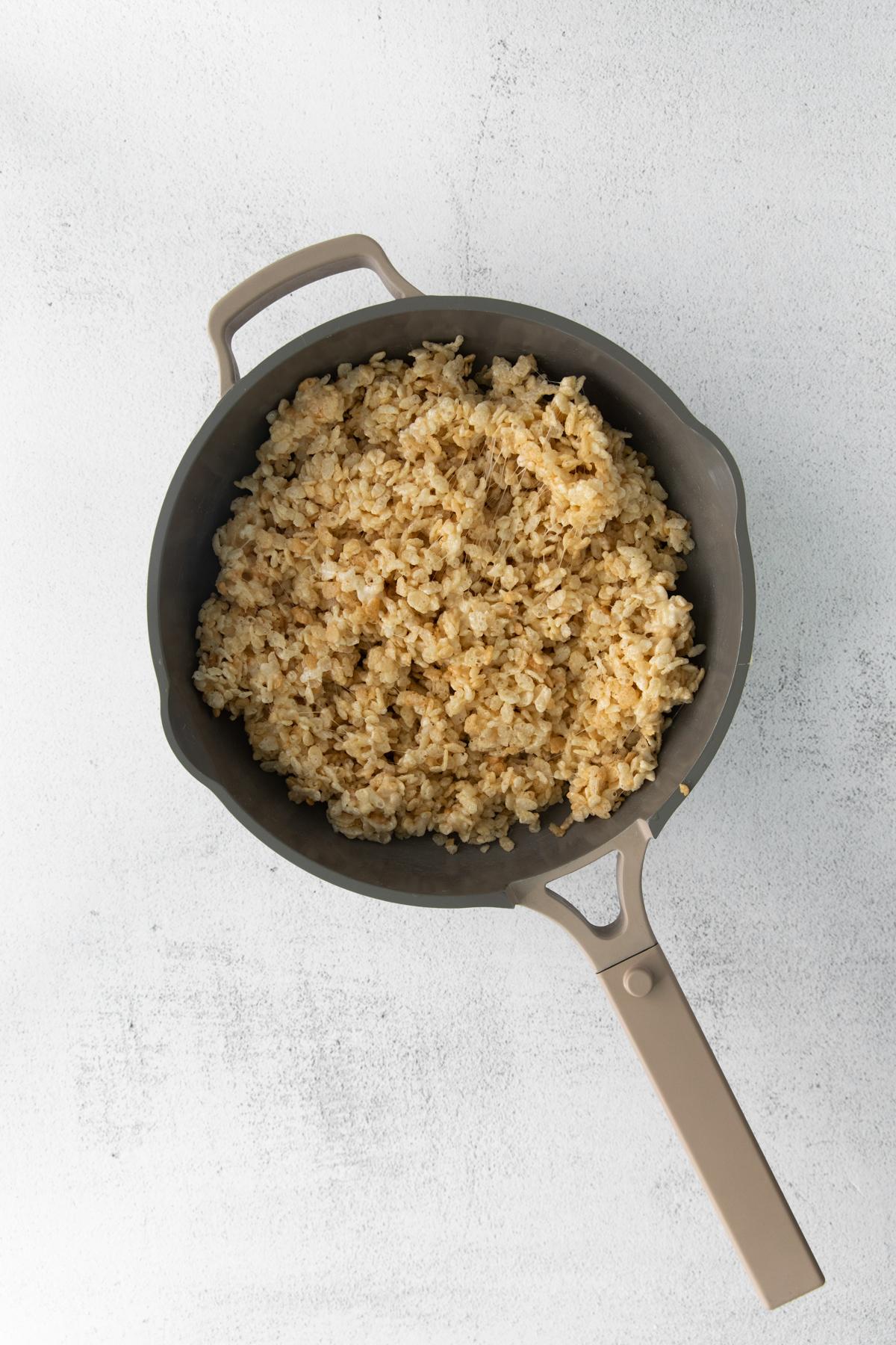 rice krispie treat mixture in a metal pan