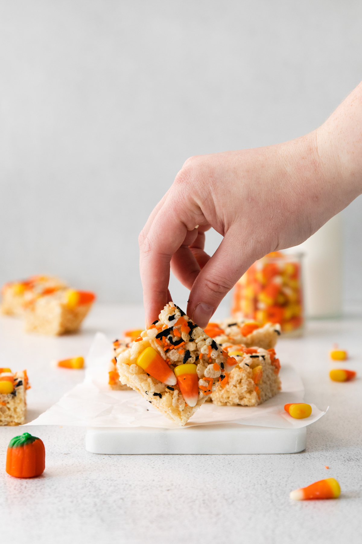 hand holding Halloween rice krispies