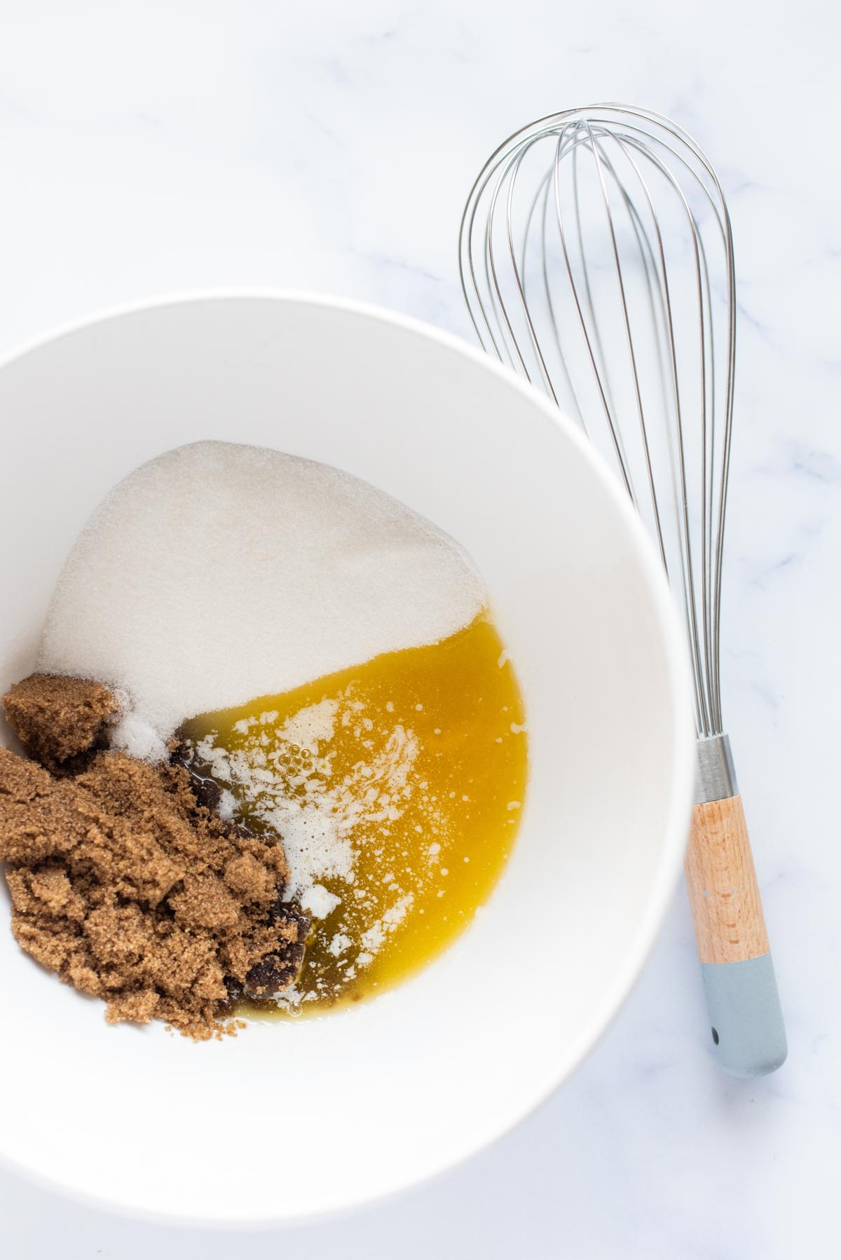 white bowl with sugar and melted butter