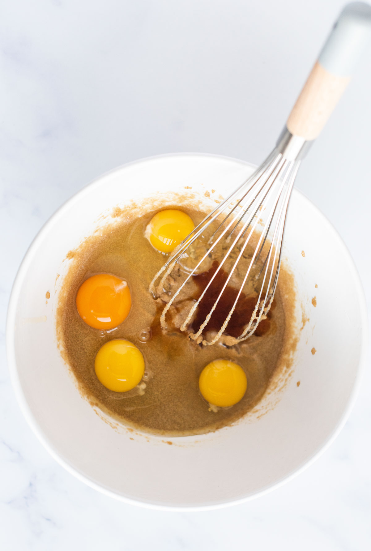 eggs and vanilla in a white bowl