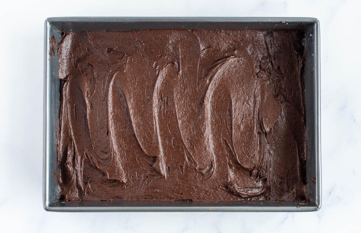 homemade brownies in a pan ready to be baked