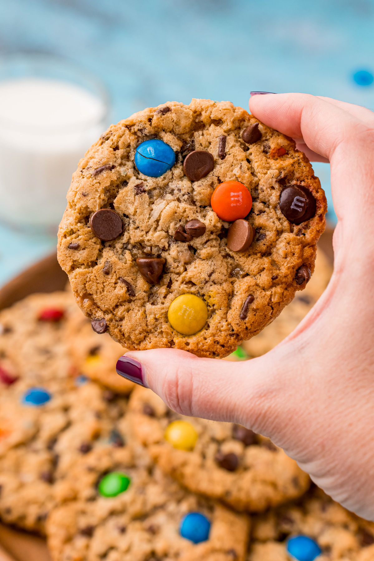 hand holding a monster cookie