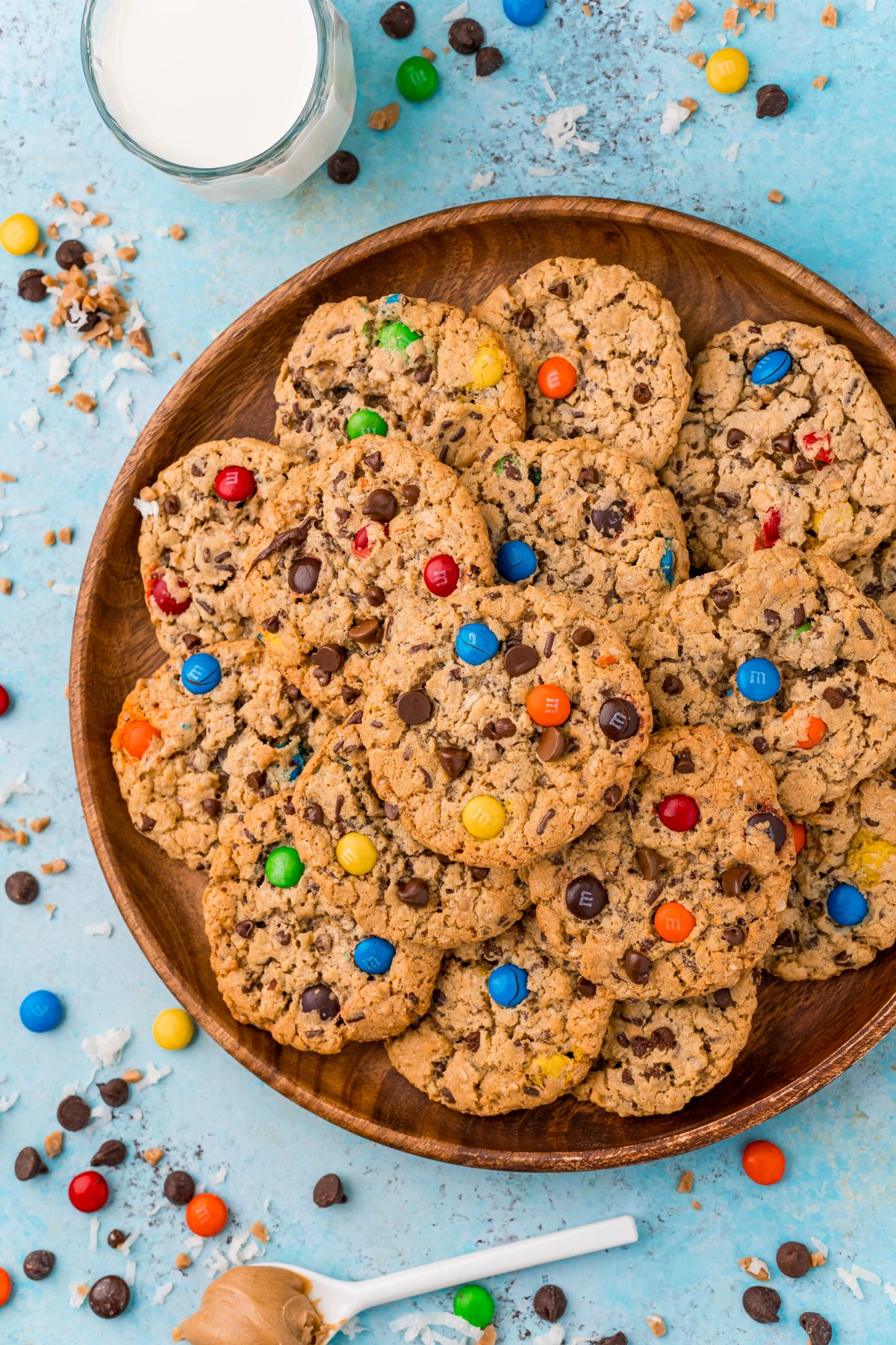 wood plate with a pile of monster cookies