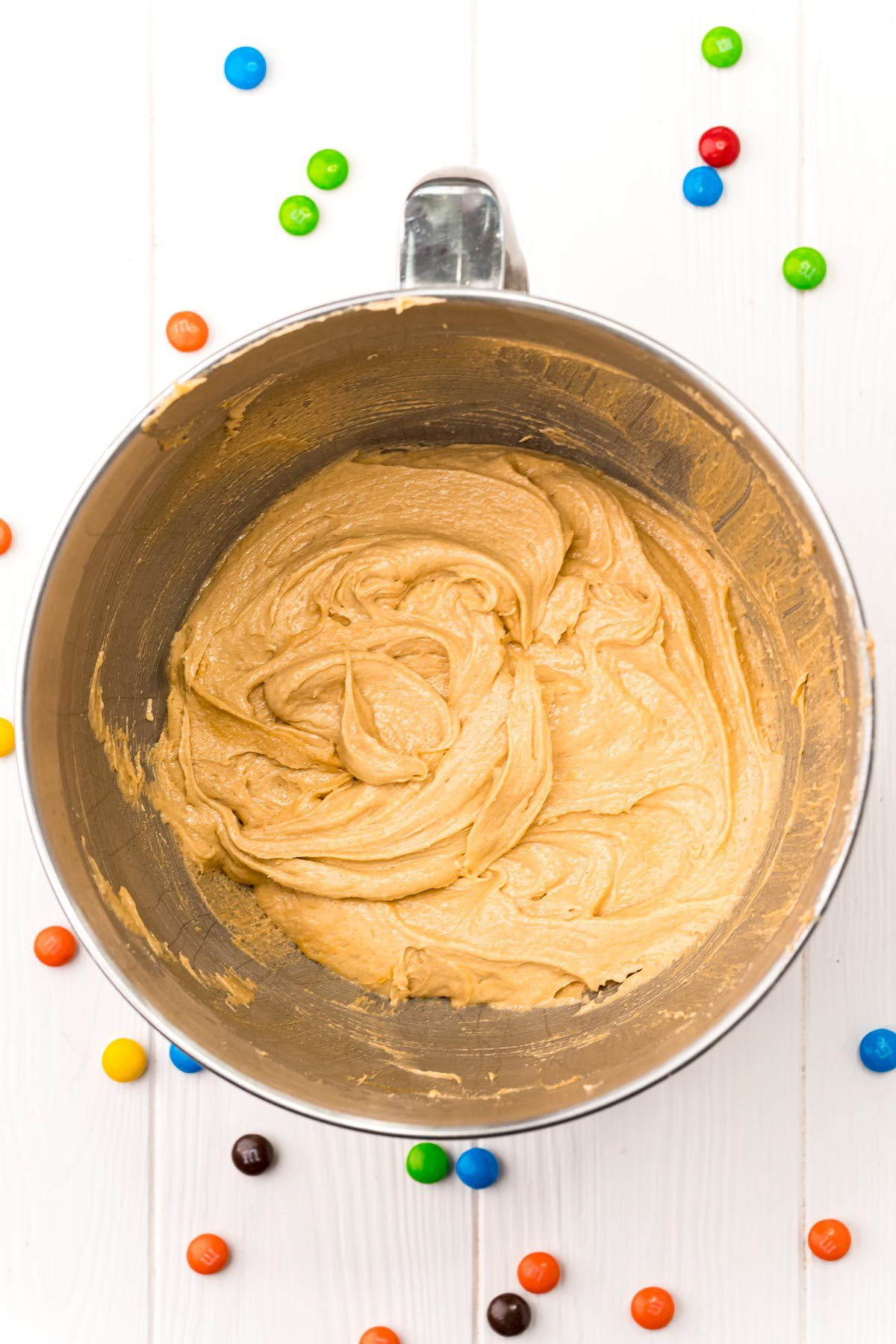 dough for monster cookies in a metal bowl
