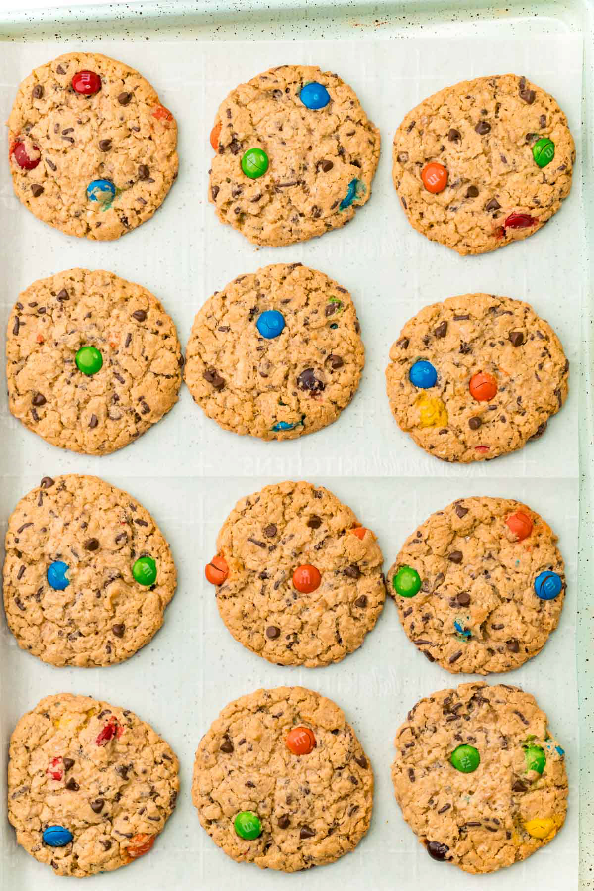 baked monster cookies on a baking sheet