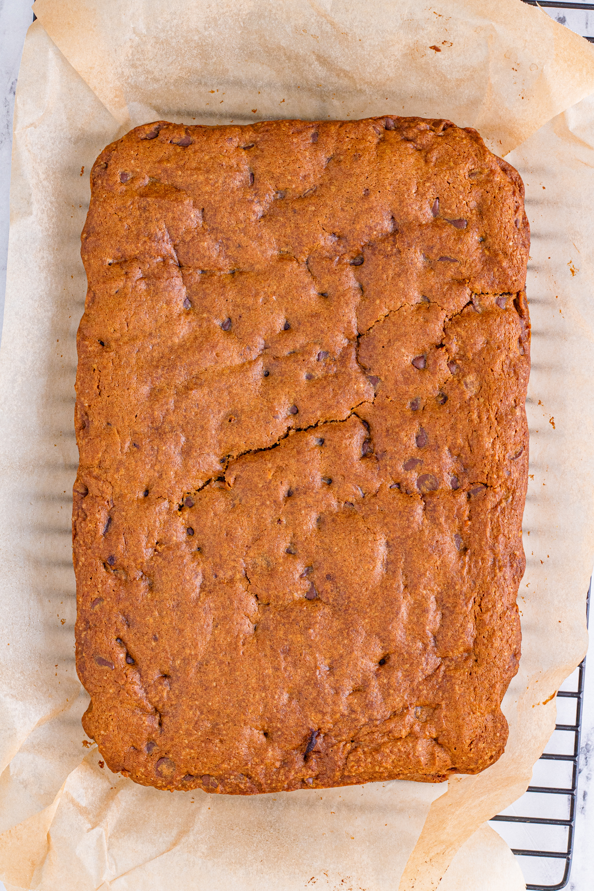 baked pumpkin blondies on a piece of parchment paper