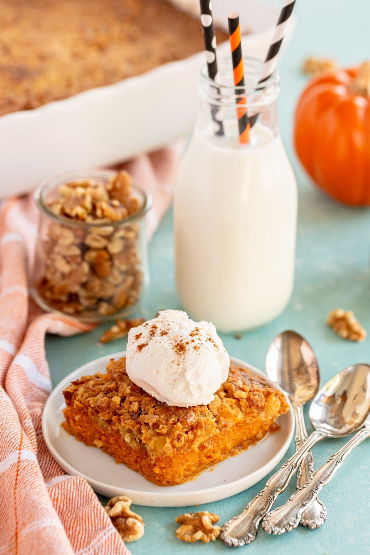 piece of pumpkin crunch cake with milk in the background