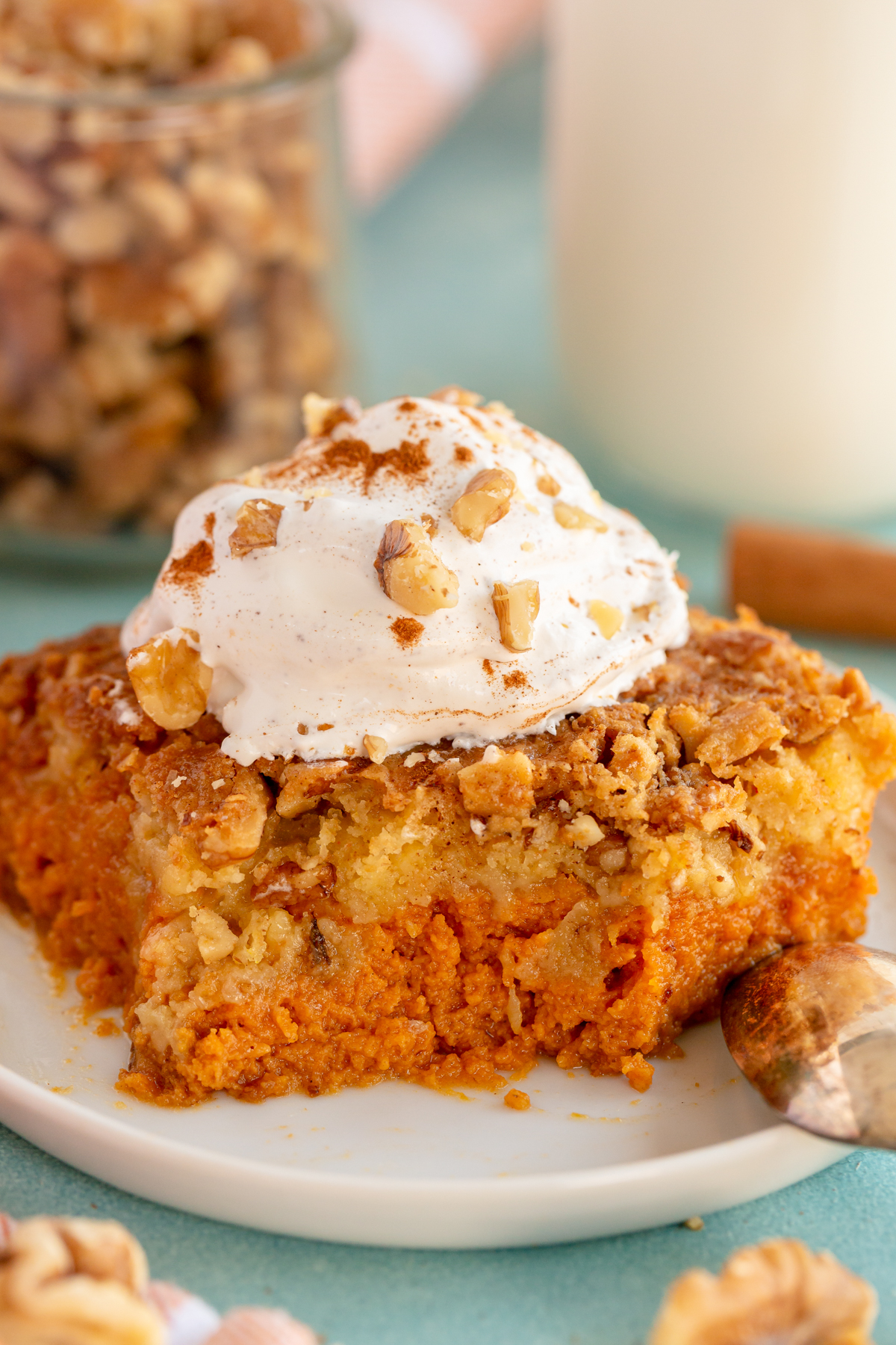 piece of pumpkin crunch cake with whipped cream on top