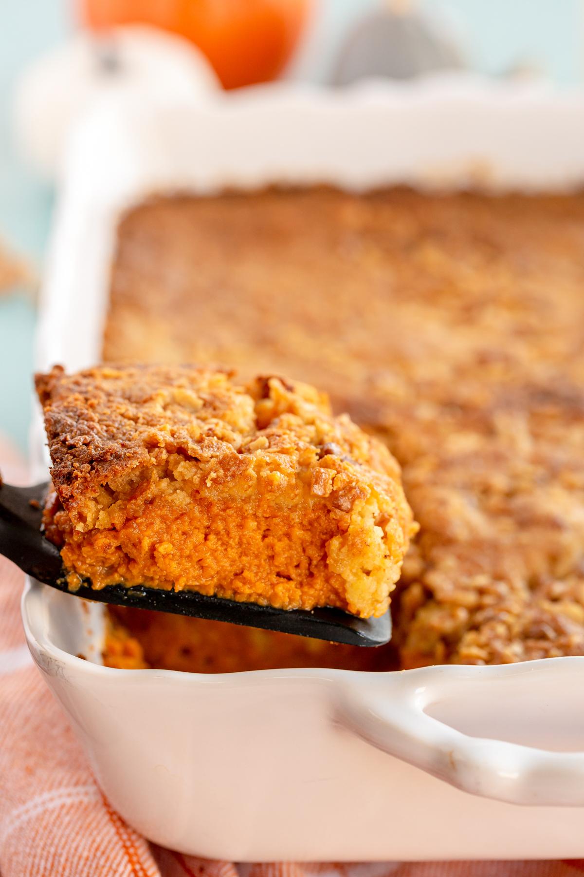 a piece of pumpkin crunch cake on a spatula