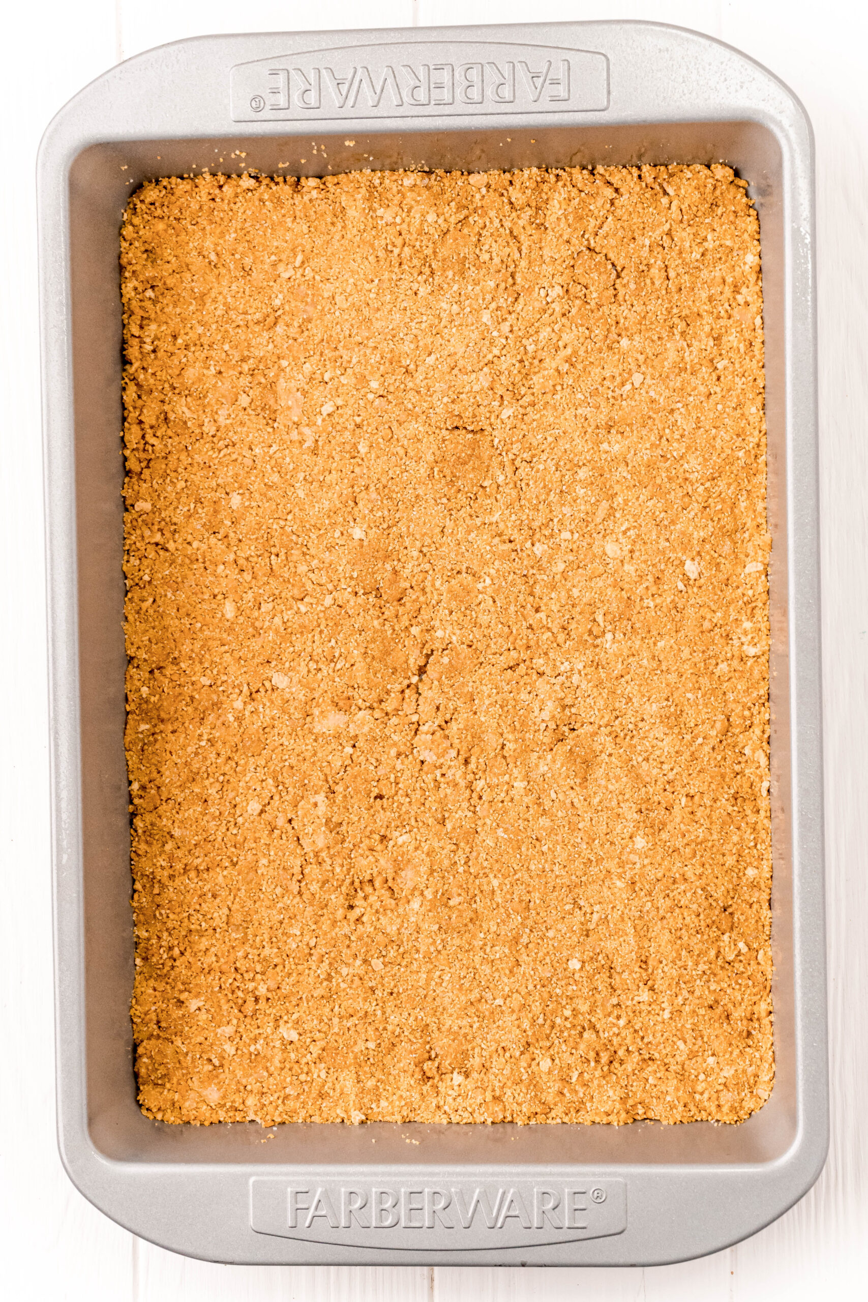 baking pan with a graham cracker crust