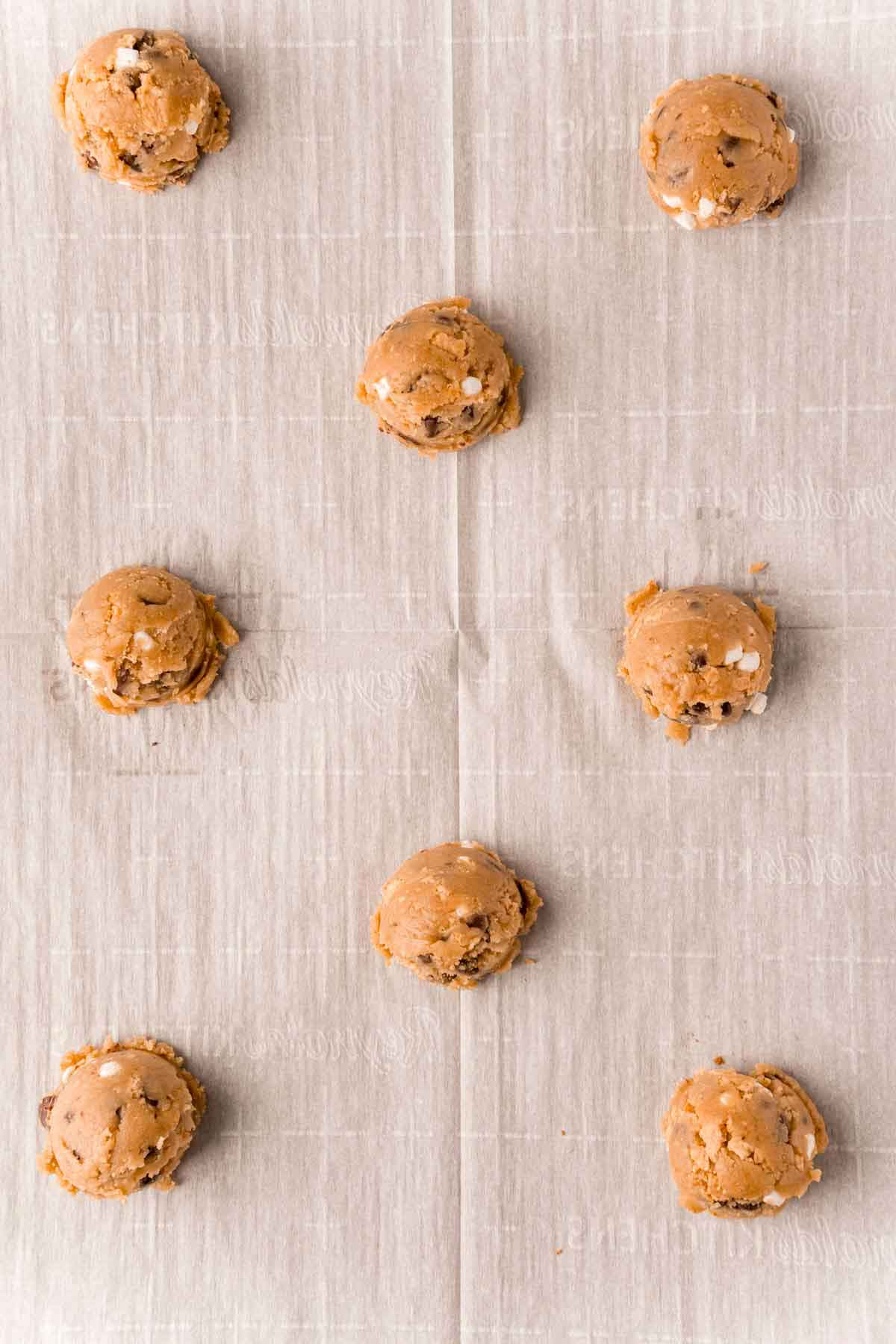 s'more cookie dough balls on a baking sheet