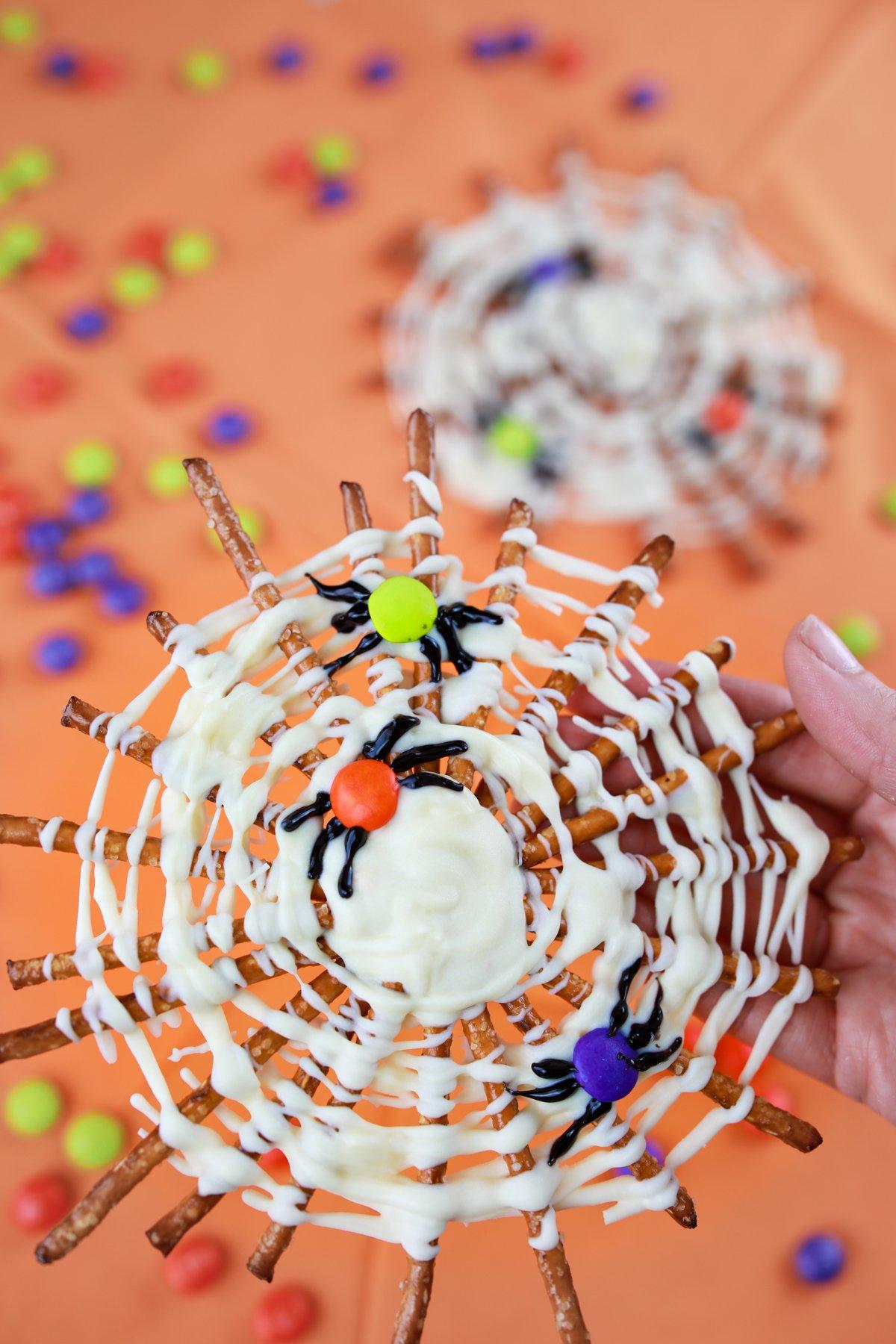 pretzel spider webs on an orange background