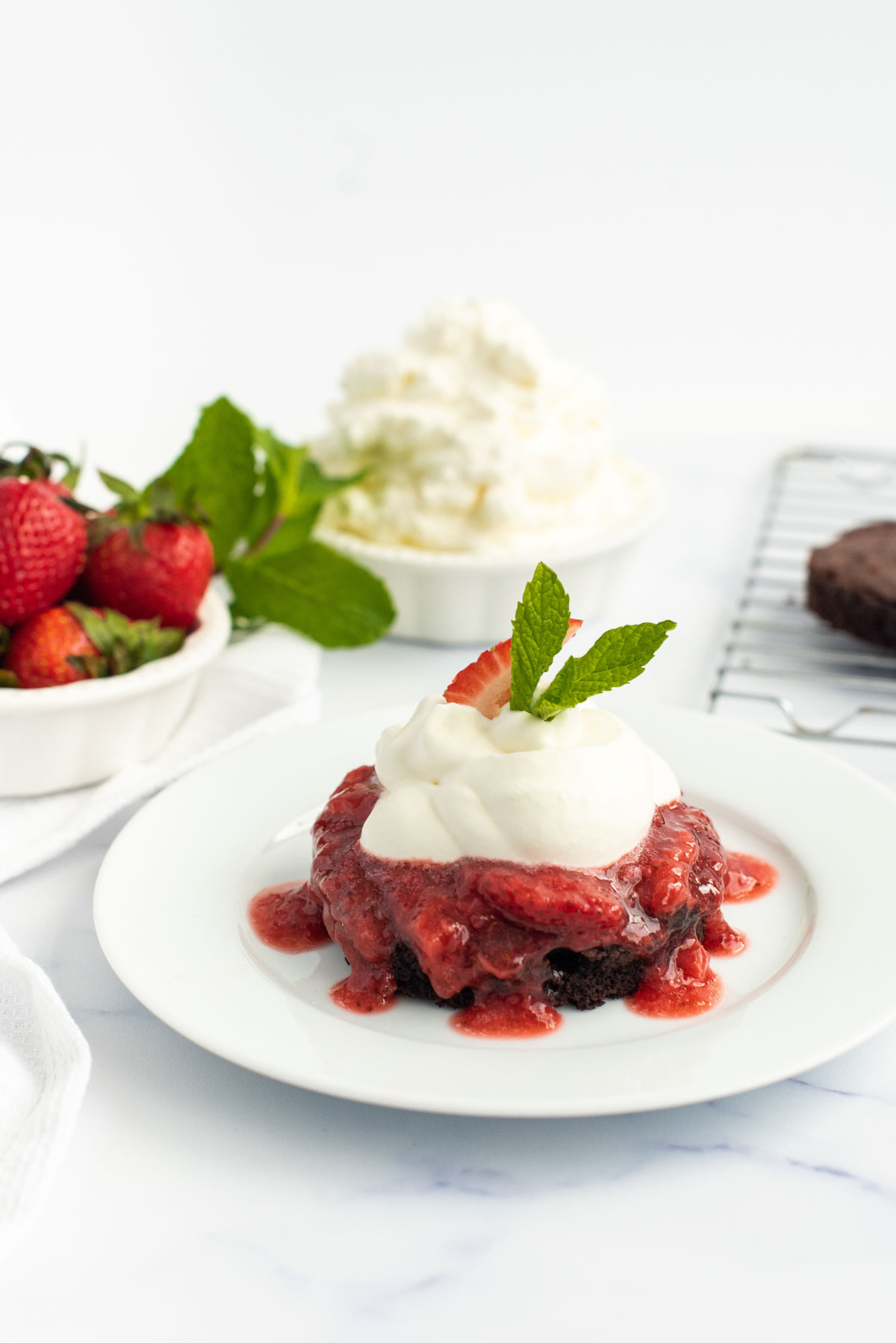 homemade brownies topped with strawberry sauce