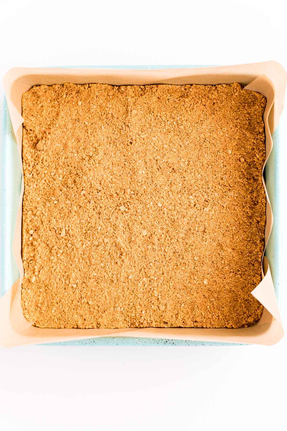 square baking pan with a graham cracker crust