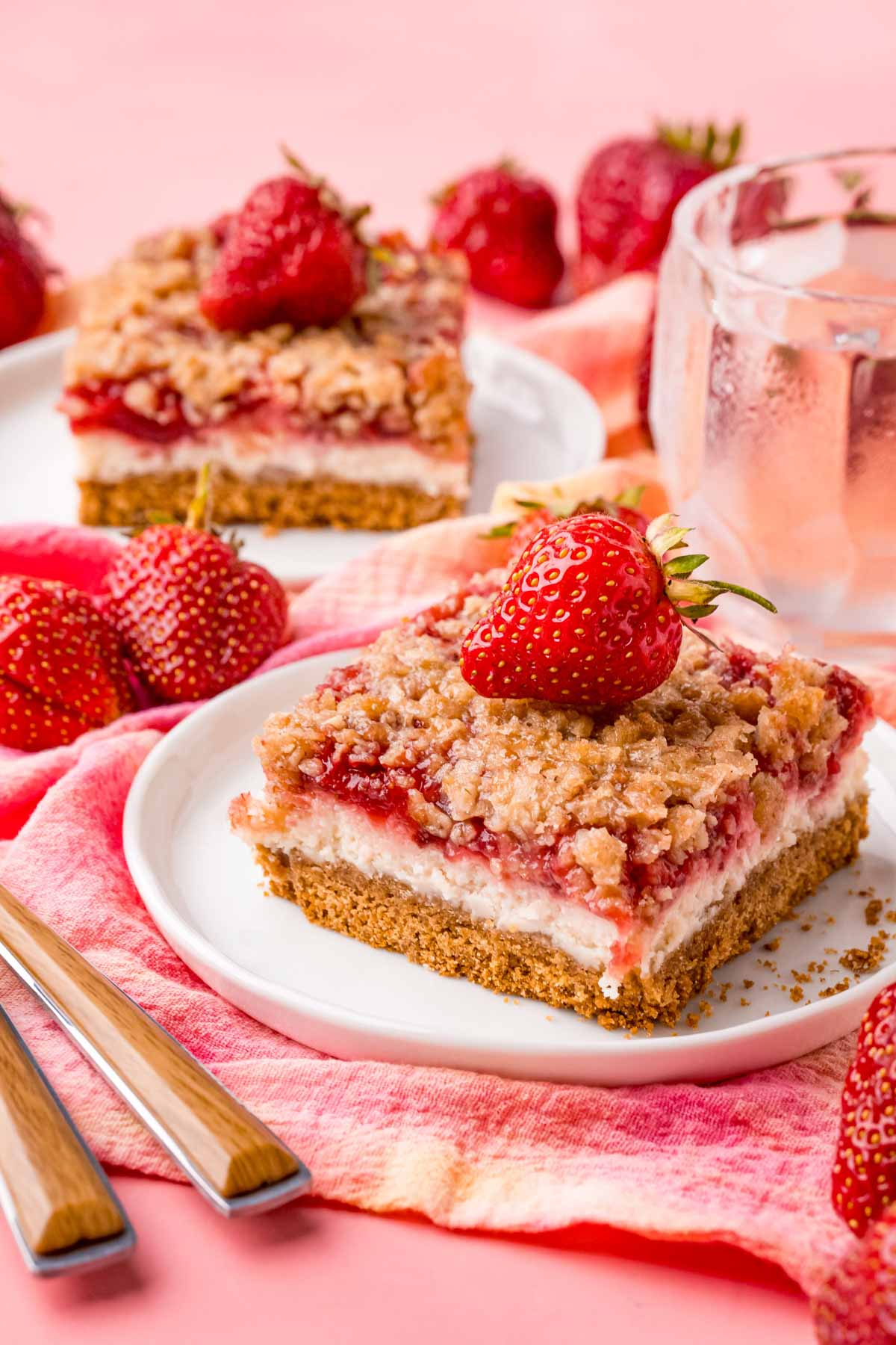 a strawberry cheesecake bar on a white plate