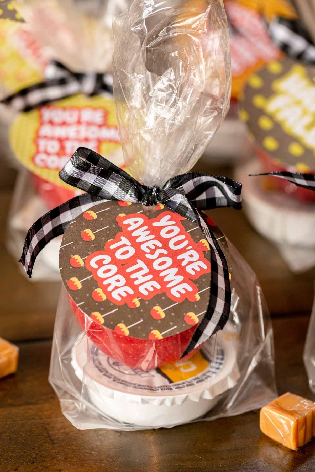 caramel and apple in a bag with a tag
