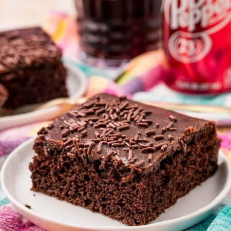 piece of Dr Pepper cake on a white plate