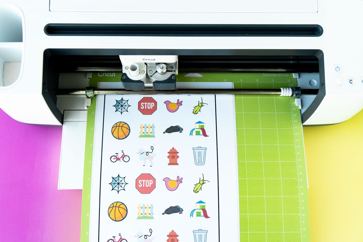 outdoor scavenger hunt stickers loaded into a Cricut Maker