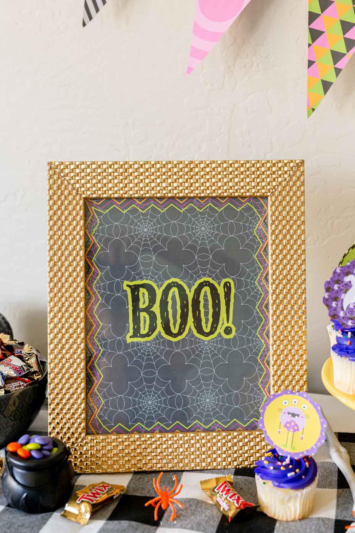 Framed Halloween wall art on a table