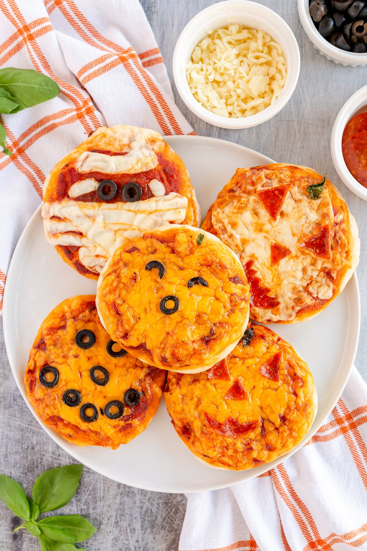 five pumpkin pizzas on top of each other