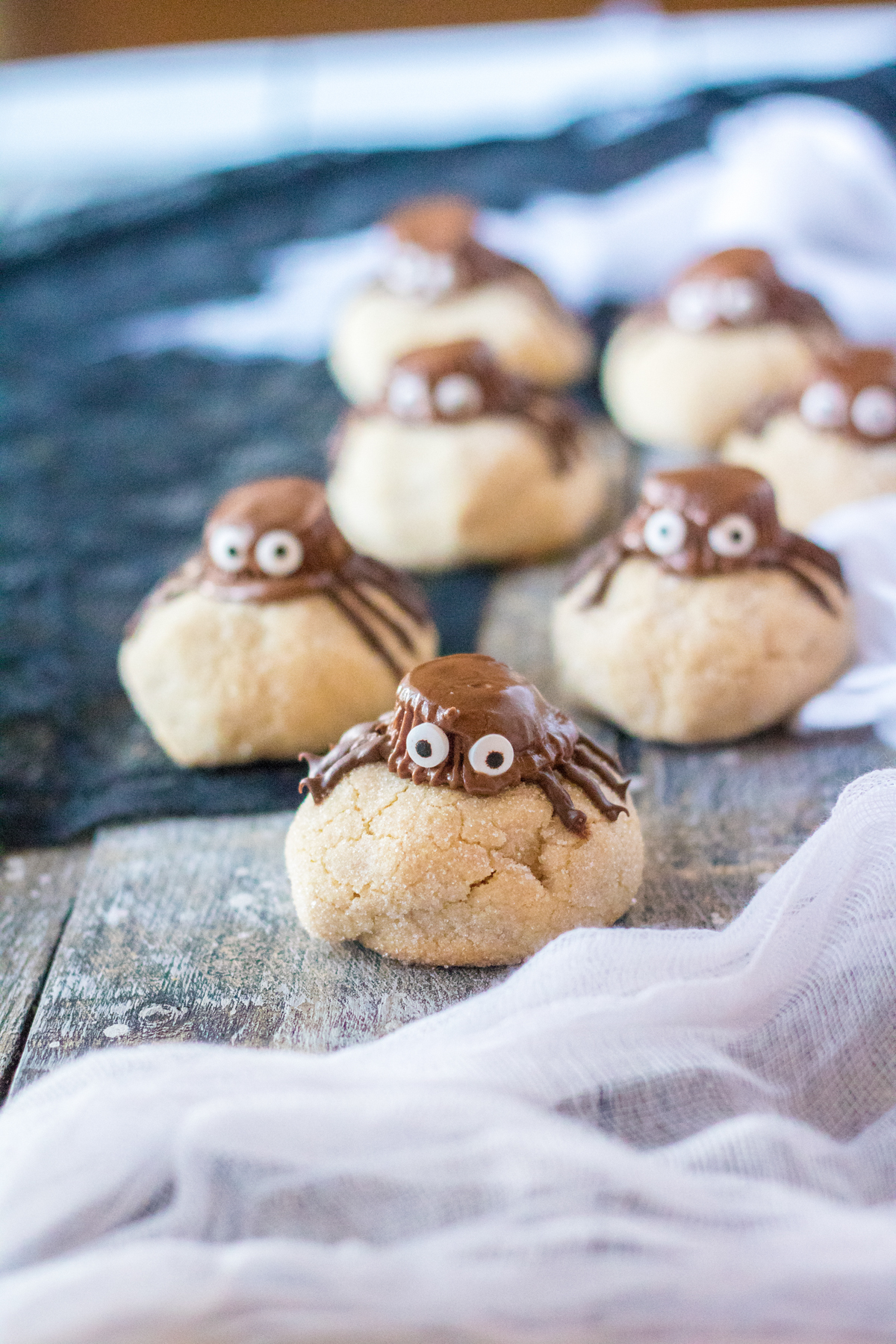 peanut butter spider cookies with a spider web tablecloth