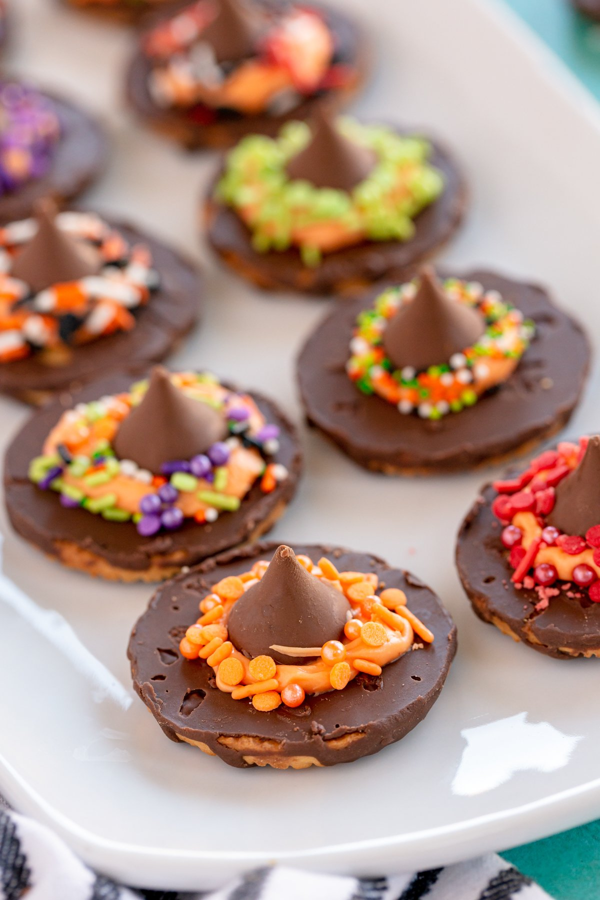 witch hat cookies on a white plate