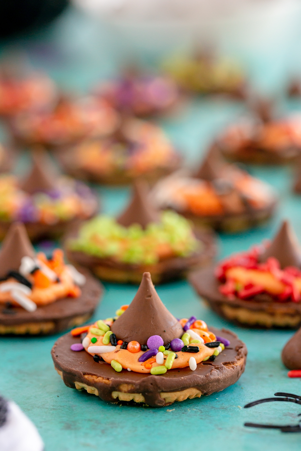 a bunch of witch hat cookies